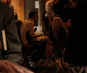 Performer Ali Stroker greets an audience member